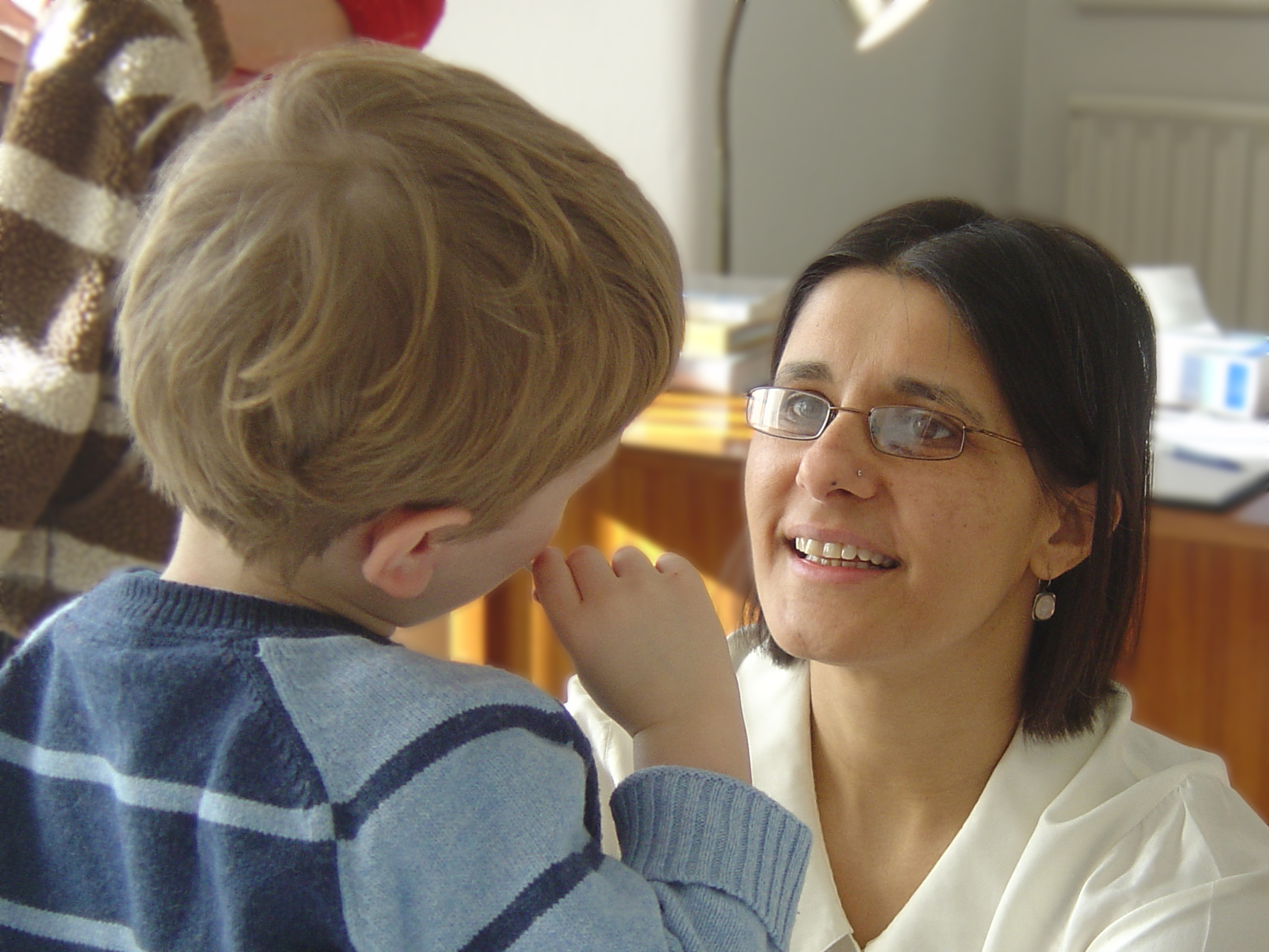 Balwant with child - acupuncture for babies, children and young people
