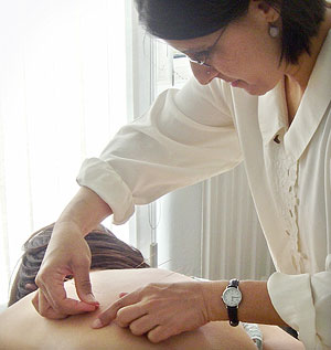 Balwant doing acupuncture - hay fever